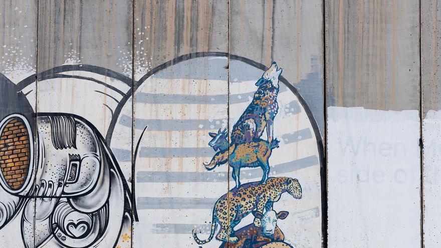 Arte urbano sobre animales en el muro fronterizo con Israel