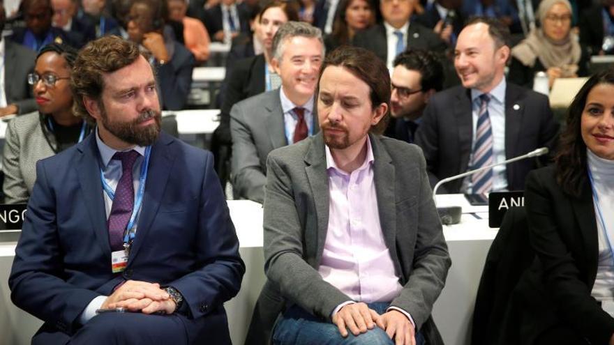 La portavoz de Ciudadanos en el Congreso, Inés Arrimadas (d), el líder de Unidas Podemos, Pablo Iglesias (c) y el diputado por Vox, Iván Espinosa de los Monteros (i) durante la ceremonia inaugural de la vigésimo quinta conferencia del clima de la ONU.