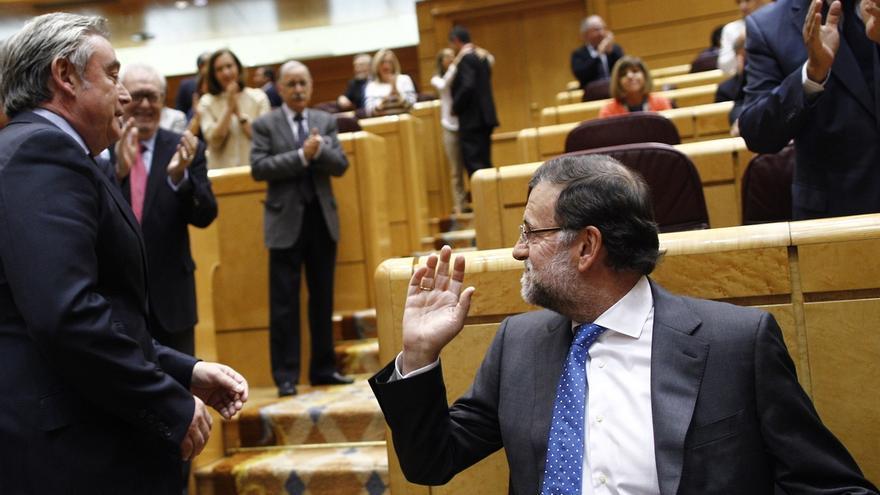 """PSOE aconseja a Rajoy """"ir haciendo las maletas"""" y el presidente presume de ser fuerza más votada"""