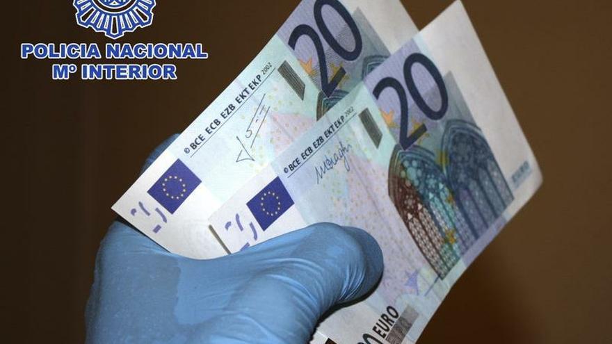Fotografía facilitada por la Policía Nacional de moneda falsificada.
