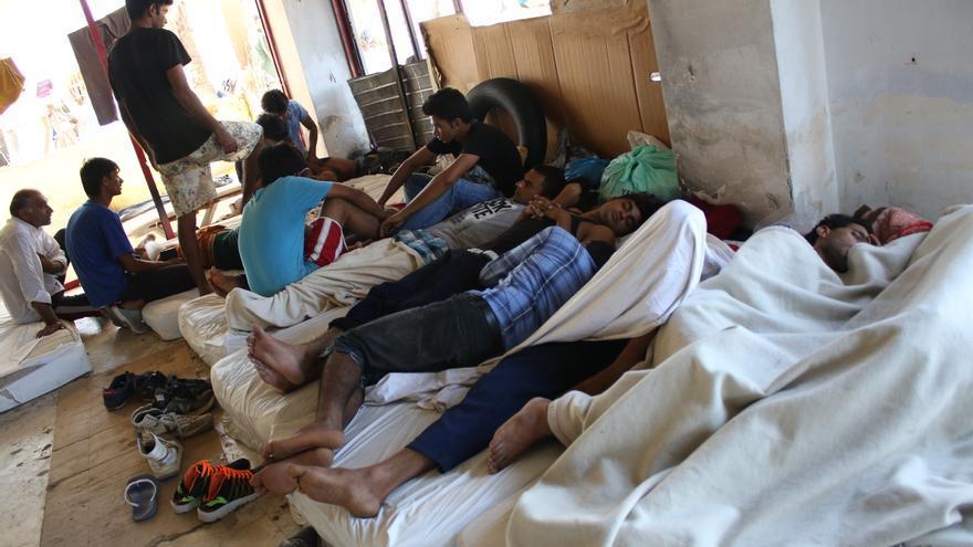 Refugiados e inmigrantes en un hotel abandonado de la Isa de Kos/ Aitor Sáez
