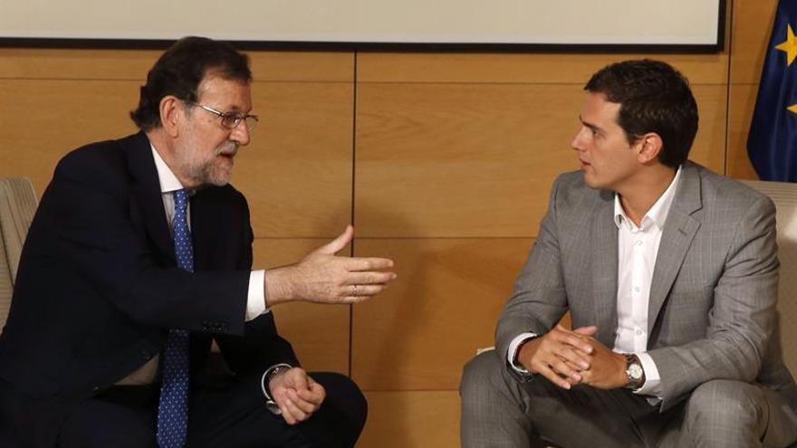 Mariano Rajoy y Albert Rivera, cuando negociaban la investidura.