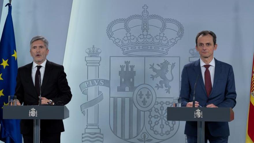 Los ministros Fernando Grande-Marlaska y Pedro Duque.