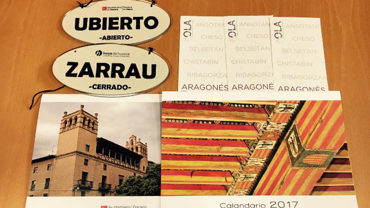 Carteles en aragonés en numerosas tiendas de la Huesca