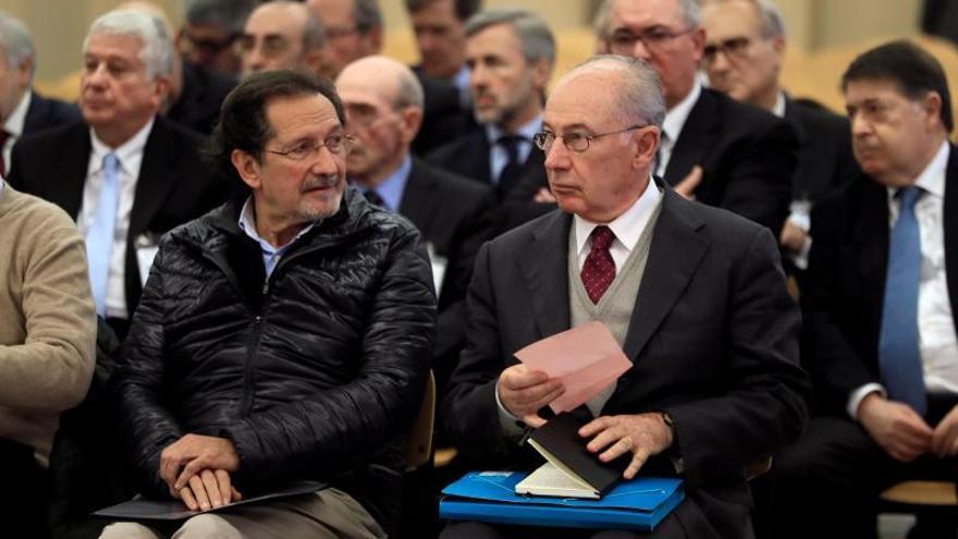 Rodrigo Rato, exministro de Economía, y José Antonio Moral Santín, exdirigente de IU, en el juicio del caso Bankia.