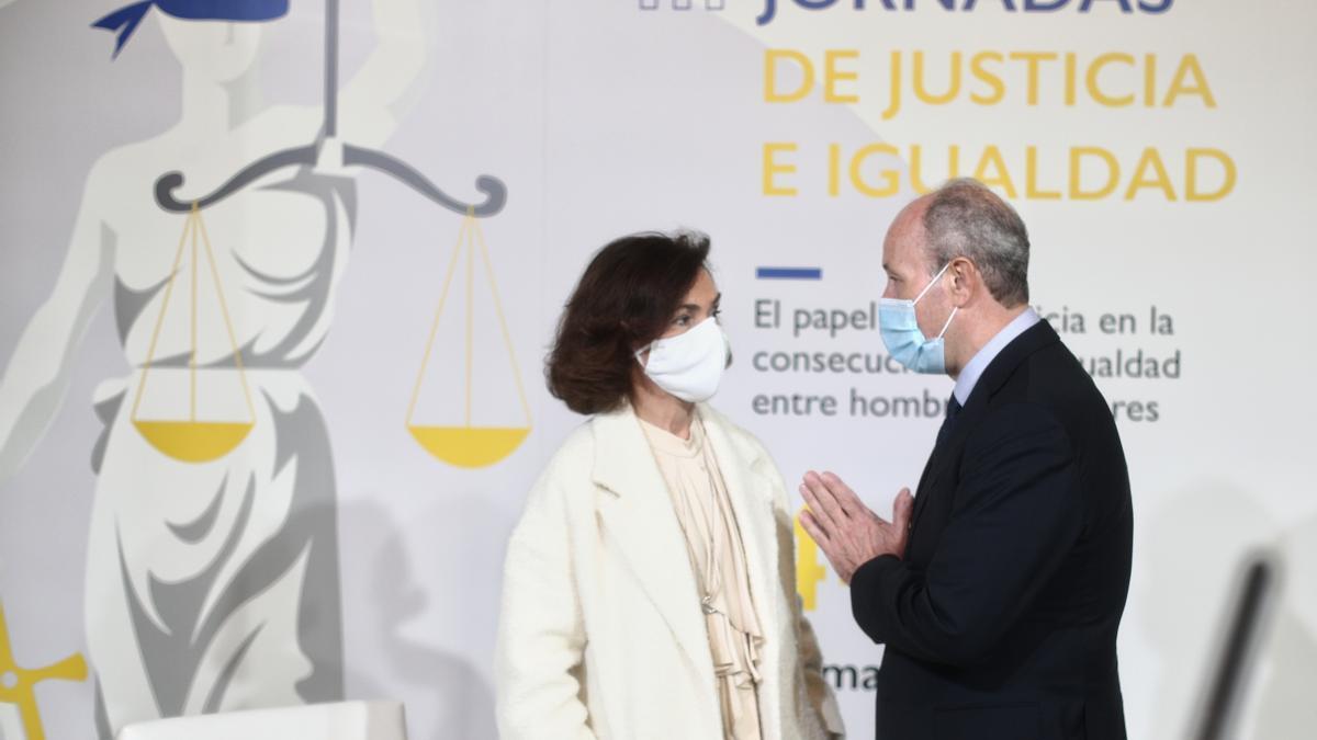 Los exministros Carmen Calvo y Juan Carlos Campo.