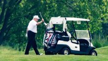 US President Donald J. Trump, wearing a white hat and white Polo shirt, plays golf at the Trump National Golf Club in Sterling, Virginia, USA, 23 May 2020.