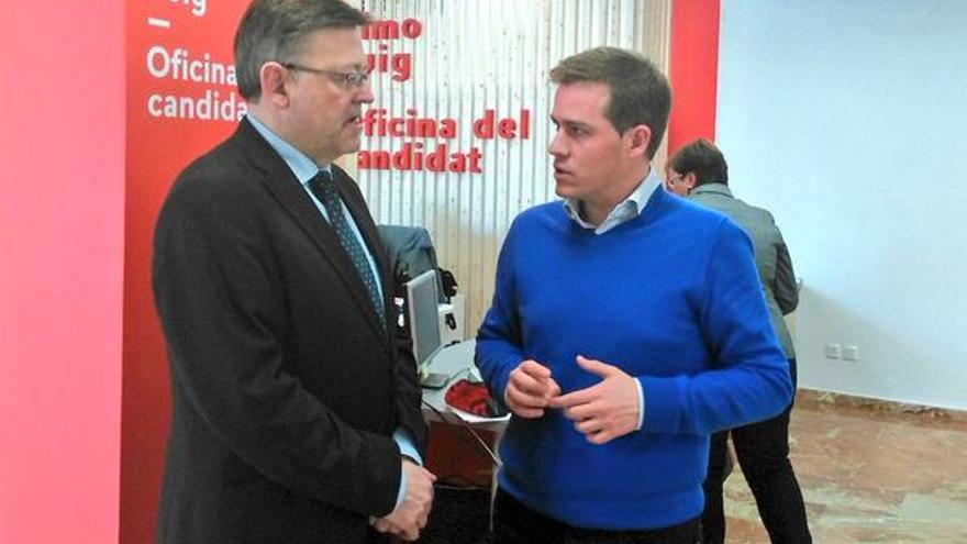 Ximo Puig y Roger Cerdá, en la sede del PSPV.