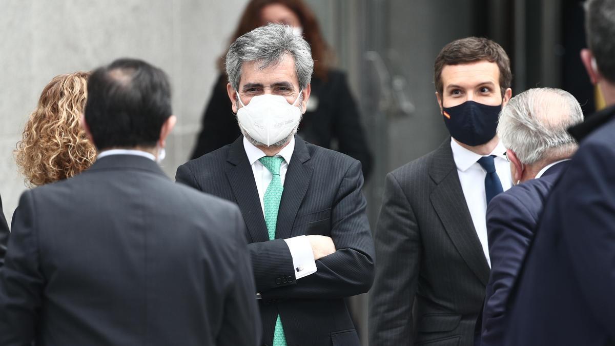 El presidente del Consejo General del Poder Judicial, Carlos Lesmes; y el líder del PP, Pablo Casado; en febrero de 2021
