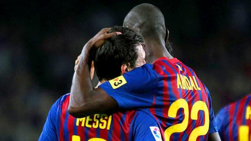 Eric Abidal con Leo Messi.