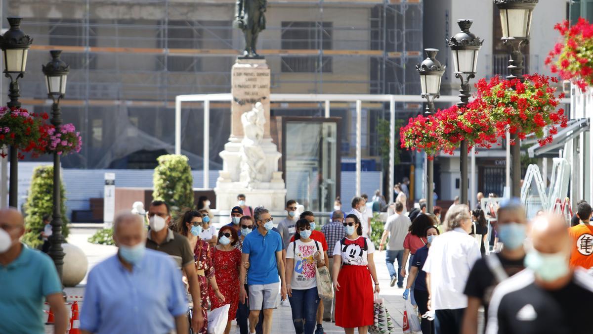 Ambiente en Málaga con personas con mascarillas