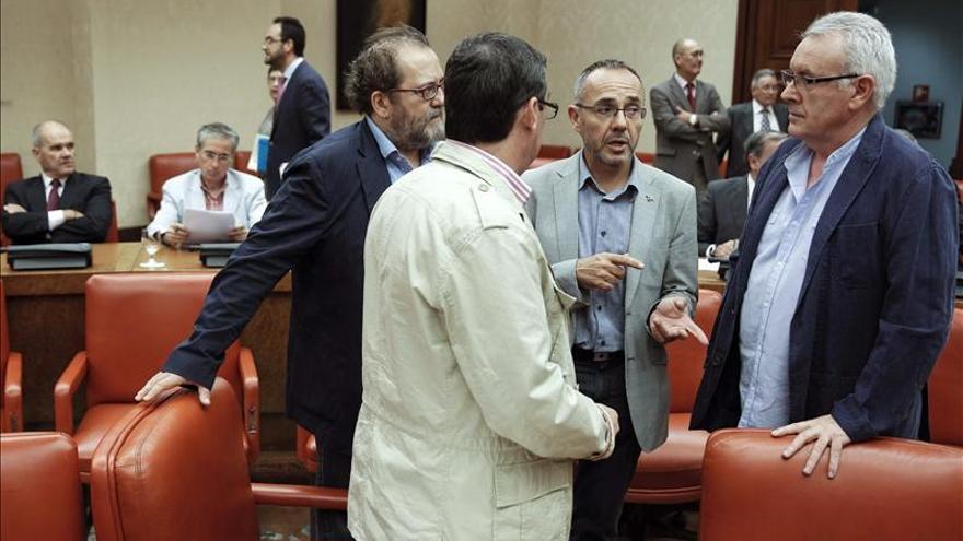 Los diputados de Izquierda Plural, Chesús Yuste, José Luis Centella, Joan Coscubiela y Cayo Lara. / Efe