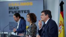Pablo Iglesias, María Jesús Montero y José Luis Escrivá, durante la presentación del ingreso mínimo vital este viernes.