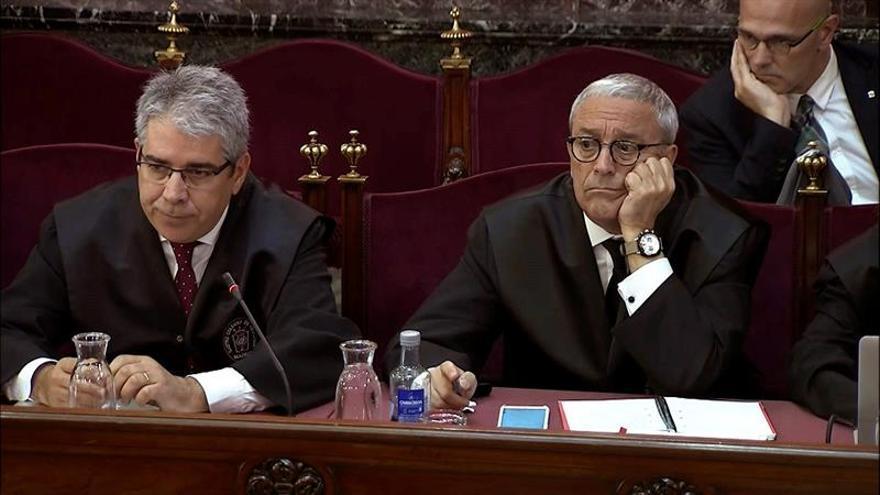Melero (d), junto al exconseller y ahora abogado Francesc Homs