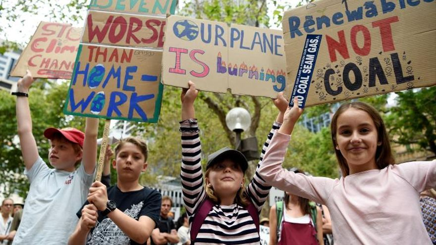 Protesters hold placards during the Climate Crisis National Day of Action rally in Sydney, Australia, 22 February 2020.