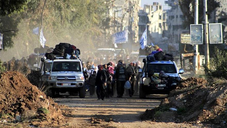 El viaje de ida y vuelta de una familia siria evacuada de un barrio asediado