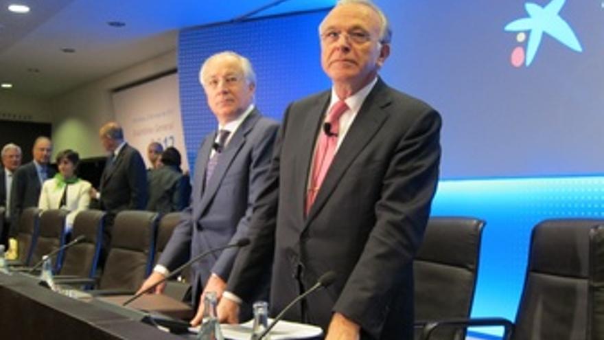 El Presidente De La Caixa, Isidre Fainé, Y El Director General, Juan María Nin