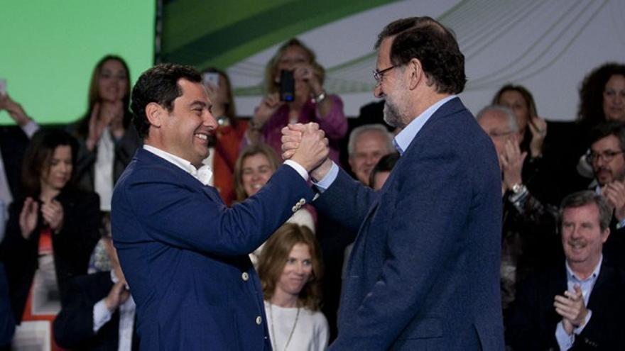 Juanma Moreno y Mariano Rajoy, en un mitin en Málaga.