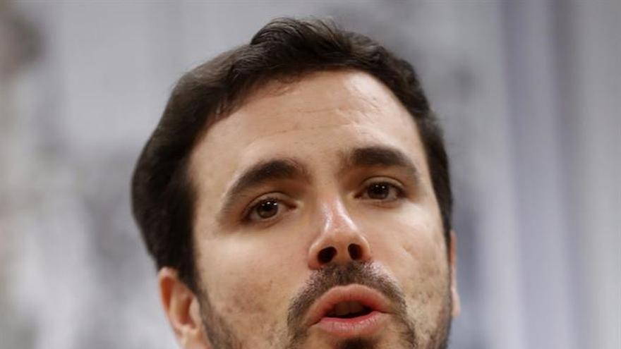 Garzón asegura que no se va a liquidar ni disolver a IU dentro de Podemos