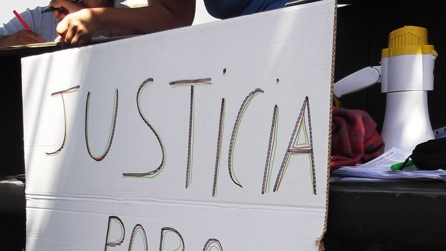 En la imagen, un cartel reivindicativo del acto de Los Llanos.