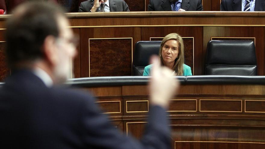 Mariano Rajoy y la exministra de Sanidad, durante un debate en el Congreso por la crisis del ébola.