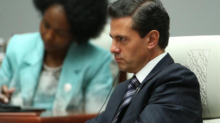 """Peña Nieto y Putin acuerdan dar """"un nuevo impulso"""" a relaciones económicas"""