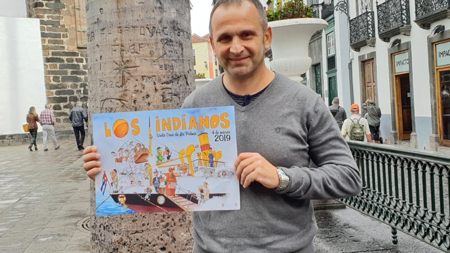 Carlos Manuel Rodríguez 'Carlines' con el cartel.