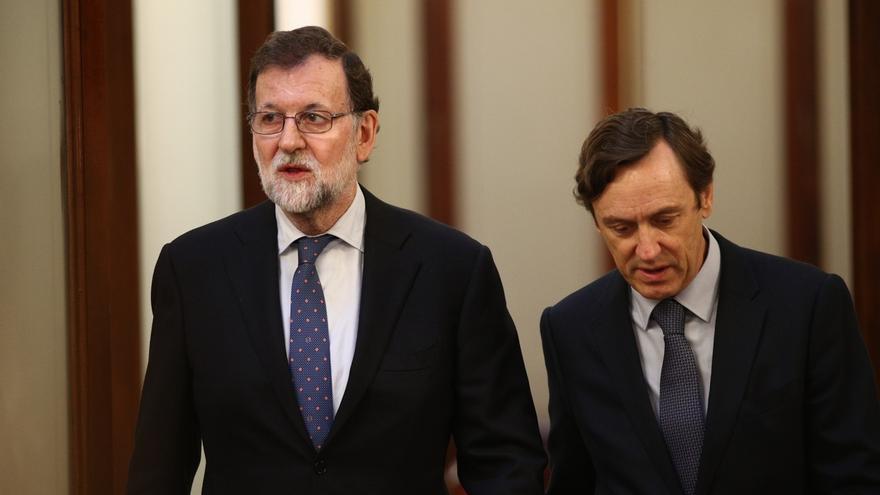 El presidente del Gobierno, Mariano Rajoy, y el portavoz del PP en el Congreso, Rafael Hernando.