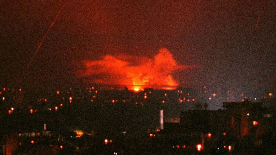 Flames rise from an explosion of a NATO bomb dropped over Belgrade overnight Thursday 27 May 1999. The number of NATO bomb raids against Yugoslavia reached a new peak on Thursday with alliance warplanes mounting nearly 400 attack missions against targets in Kosovo and throughout Serbia.