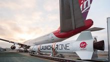 A handout photo made available by Virgin Orbit on 25 May 2020 shows a LauncherOne rocket moved into position next to Cosmic Girl, a customized Boeing 747 aircraft that is used as the rocket's 'flying launch pad', at Mojave Air and Space Port in California, USA.