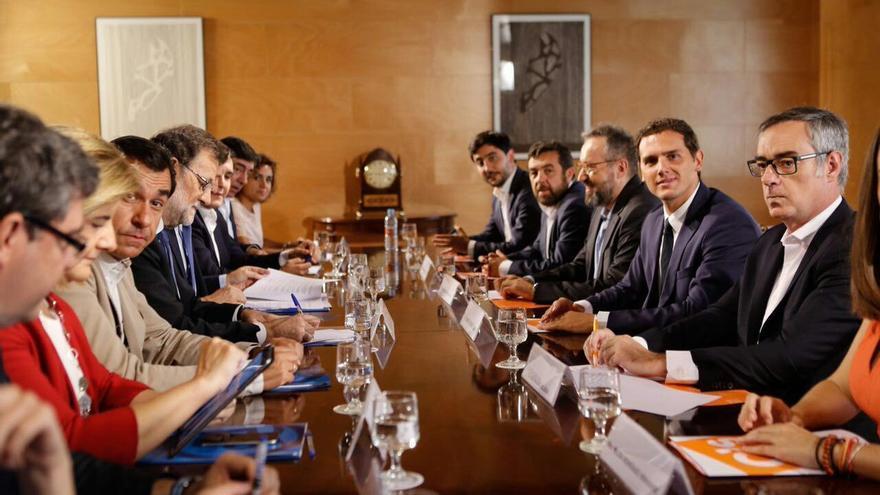 Reunión de los equipos negociadores de Ciudadanos y el Partido Popular, este domingo   Foto: @CiudadanosCs