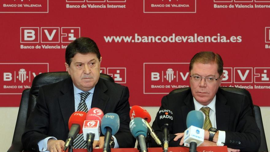 El expresidente de Bancaja, José Luis Olivas (i), junto a Domingo Parra (d)