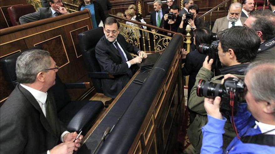 Rajoy junto a Gallardón en el Congreso