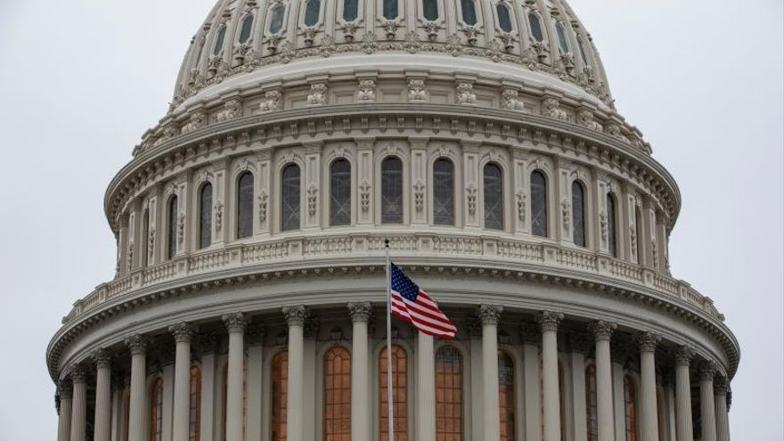 The US flag flies outside of the US Capitol in Washington, DC, USA, 14 January 2020.