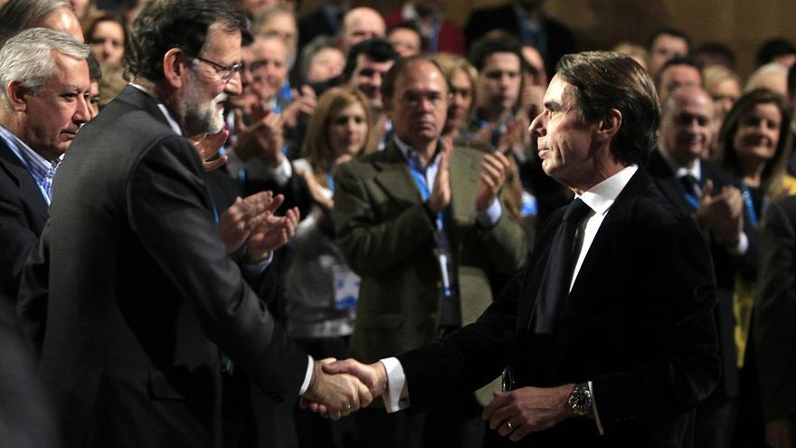 Mariano Rajoy y José María Aznar en una imagen de la Convención Nacional del PP de 2015.