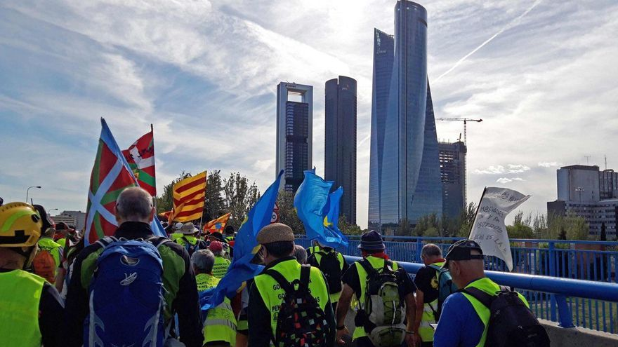 La marcha, junto a los rascacielos de Madrid