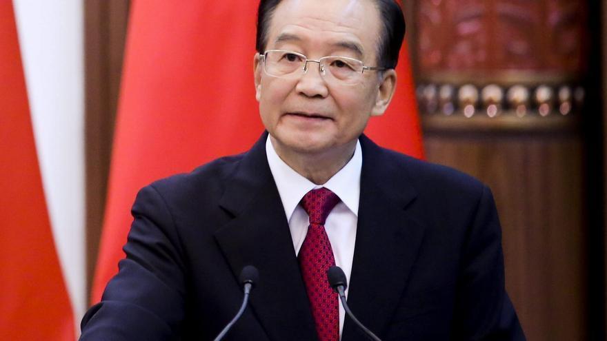 China urge a Siria a formar un gobierno de transición, tras oír el plan de Al Asad