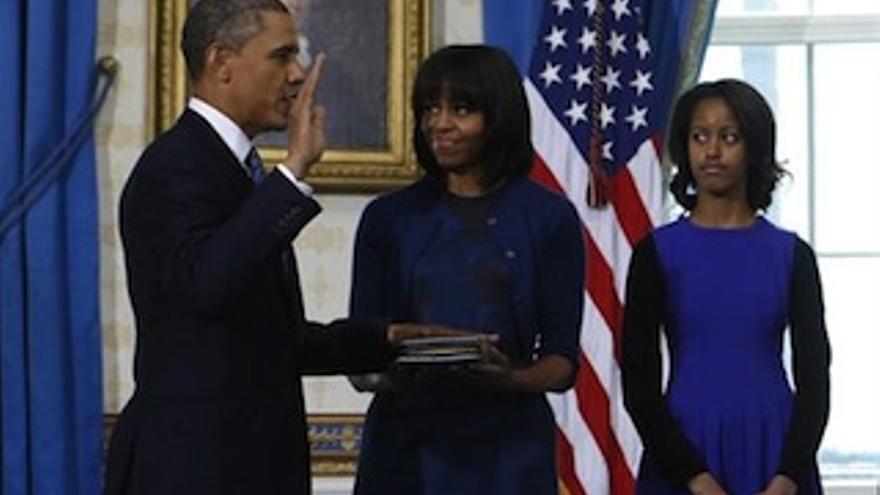 Barak Obama junto a su mujer y su hija.