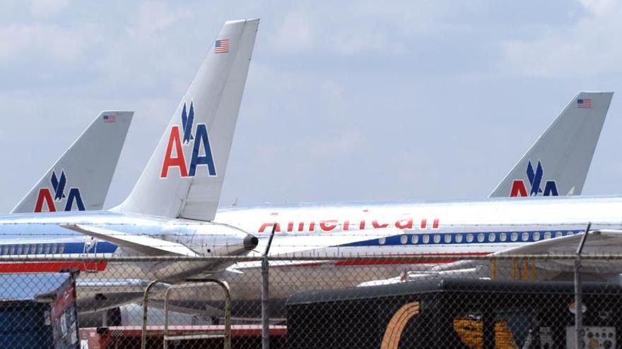 American Airlines Group perdió 1.800 millones dólares en 2013 debido a fusión