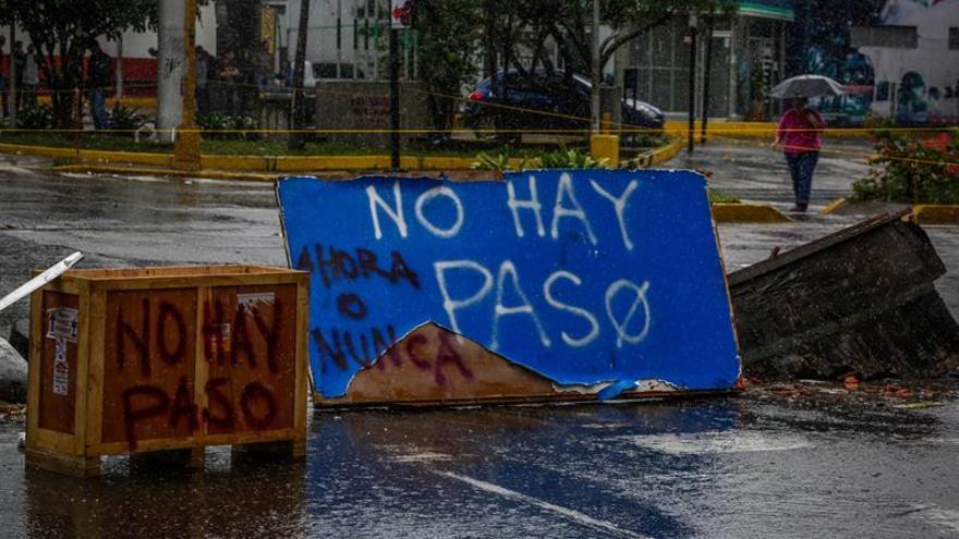 """El Gobierno y empresarios, enfrentados en la víspera del """"paro cívico"""" contra Maduro"""