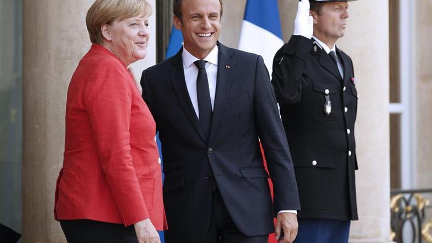 Macron y Merkel exigen a Putin y Poroshenko un compromiso claro con la tregua