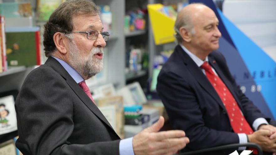 Mariano Rajoy y el exministro del Interior, Jorge Fernández Díaz, durante la presentación del libro del segundo.