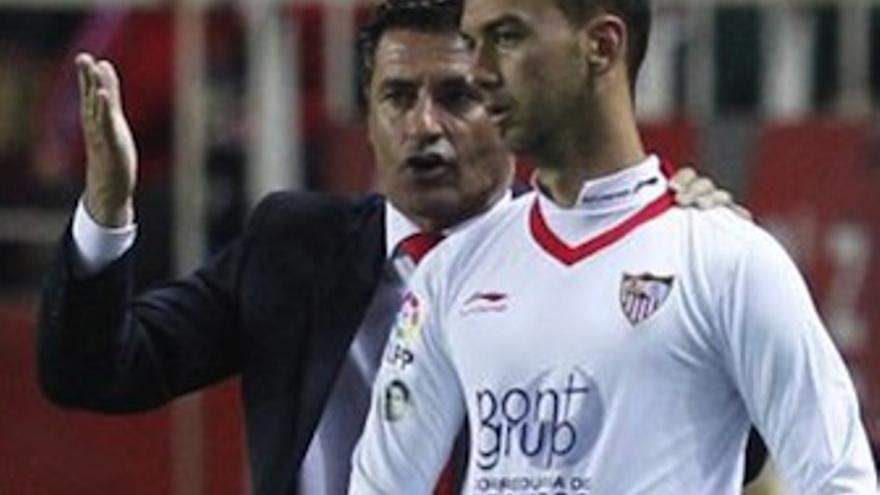 Deivid junto a Michel, el técnico que le hizo debutar en primera.