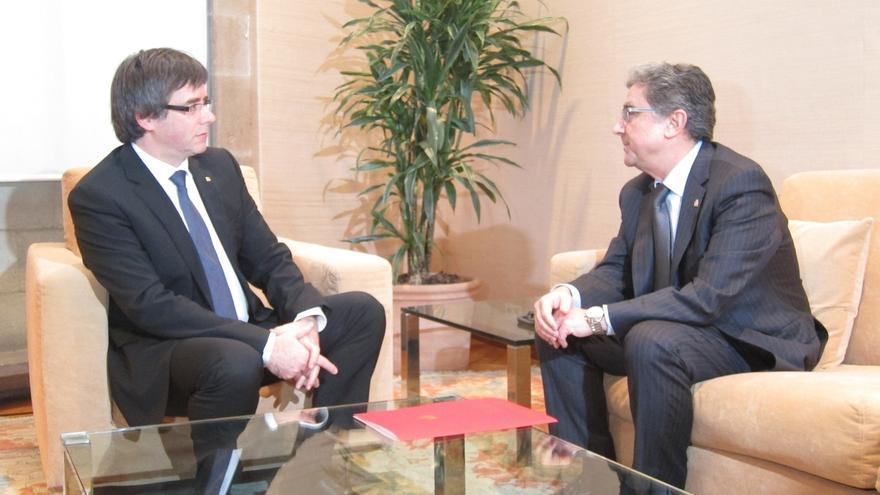 Puigdemont pide a Millo que Rajoy concrete con hechos la oferta de diálogo a Cataluña