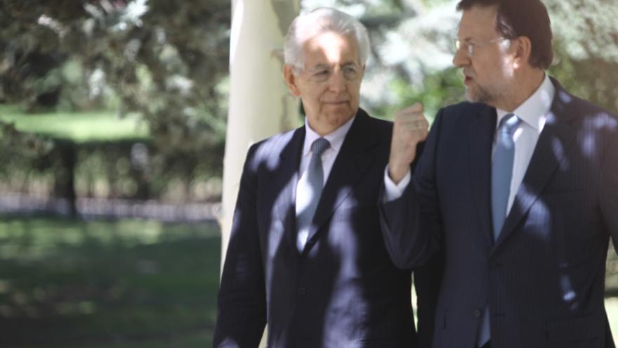 """Rajoy y Monti piden que los países de la zona euro trabajen juntos para """"estabilizar los mercados"""""""