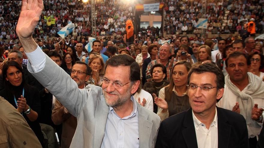 Rajoy con Feijóo, en un mitin.