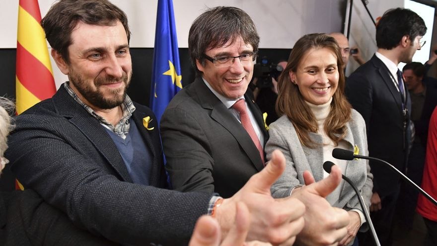 Ousted Catalan leader Carles Puigdemont, center, and former Catalan Health Minister Antoni Comin, left, gesture during a press conference at the Square Meeting Center in Brussels on Thursday, Dec. 21, 2017. The pro-secession bloc won a majority in Catalan regional elections, but the anti-independence Ciutadans (Citizens), led by 36-year-old lawyer Ines Arrimadas, won the highest number of votes for a single party. Several members of the ousted Cabinet, including Puigdemont, have campaigned from Brussels, where they sought refuge from Spanish justice.