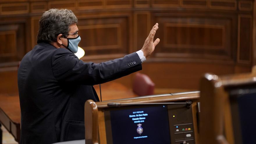 """El ministro Escrivá asegura que las """"restricciones presupuestarias"""" obligan a diferenciar las ayudas y evitar el """"café para todos"""" en los ERTE"""