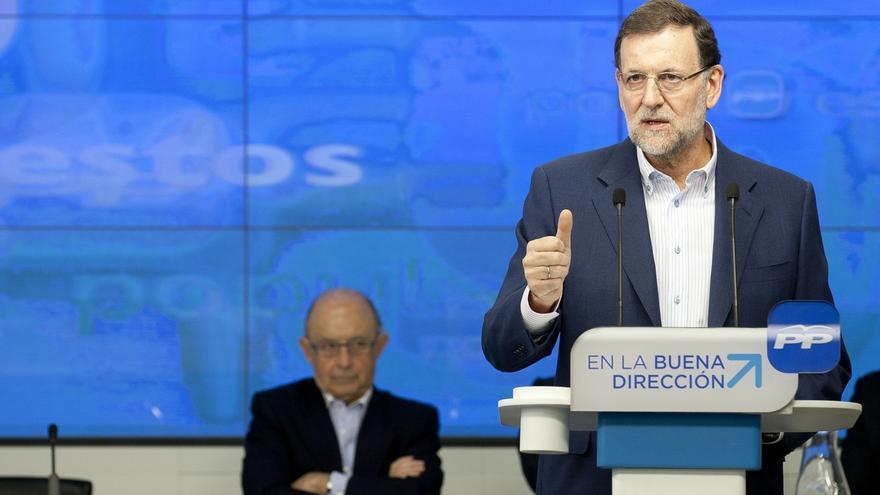 Rajoy y Montoro, en un acto del PP.