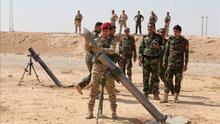 Milicias kurdas se preparan para atacar posiciones del Estado Islámico (EI) cerca de Mosul.